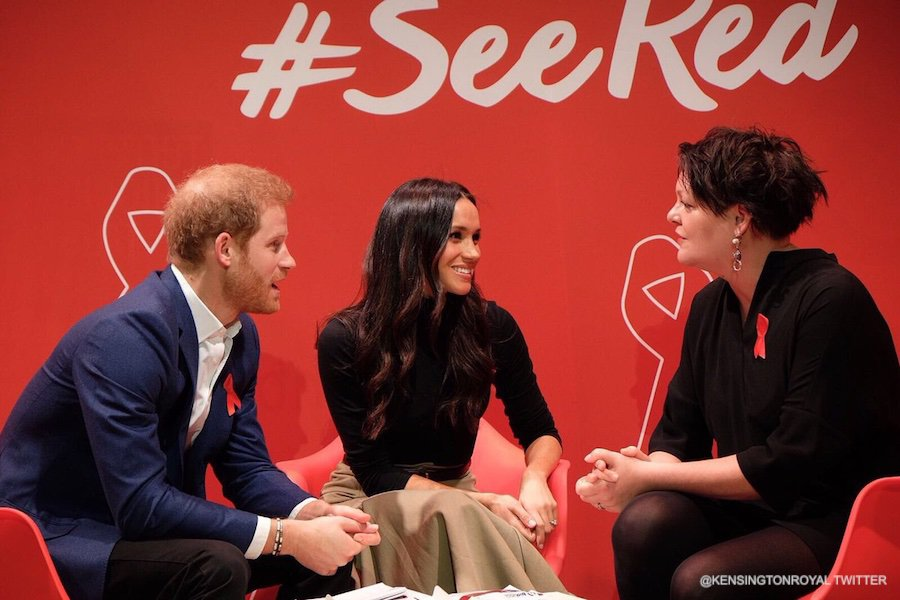 Meghan Markle in Nottingham wearing her black turtleneck sweater by Wolford