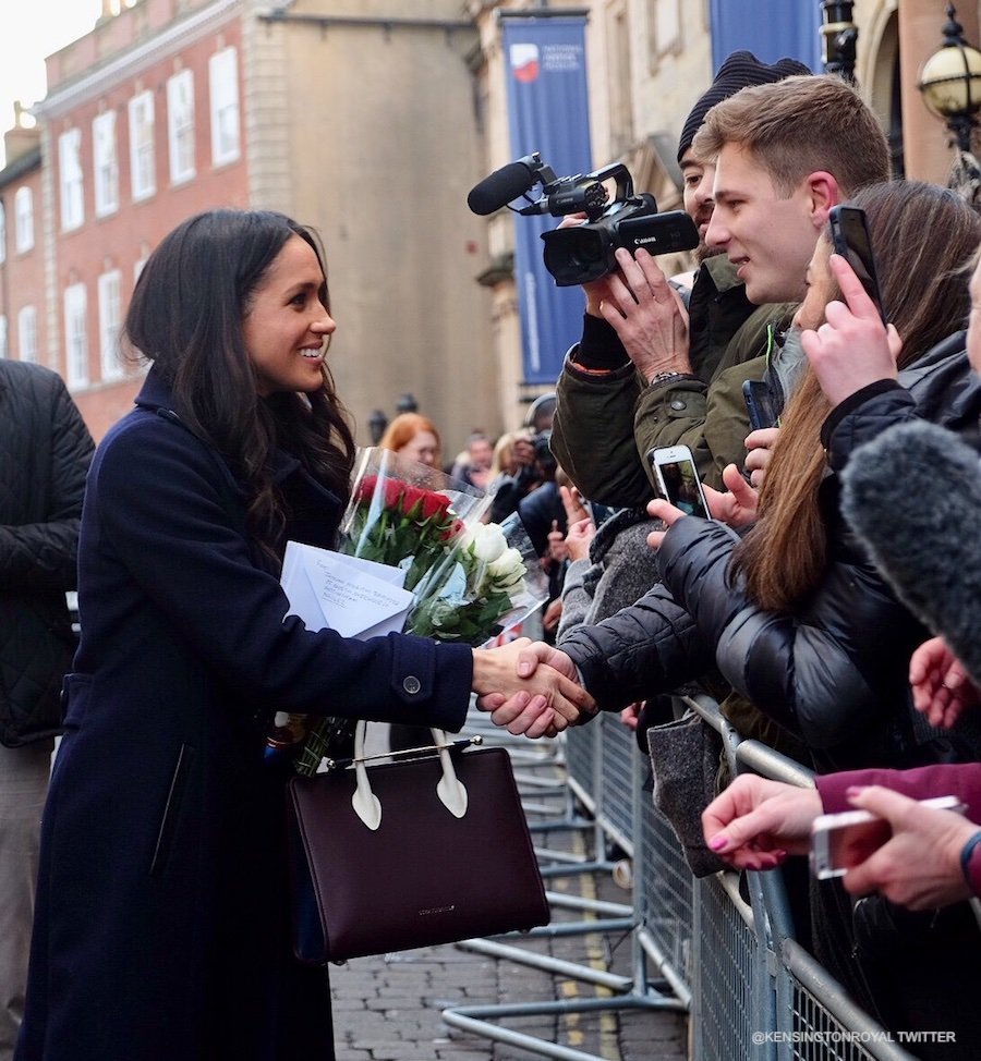 Meghan Markle meeting crowds during a walkabout in Nottingham