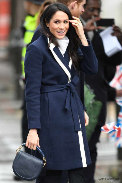 Megham Markle wearing her J.Crew coat in navy blue with white detailing