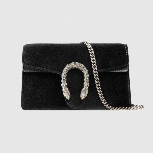 carrying the Gucci Dionysus clutch bag