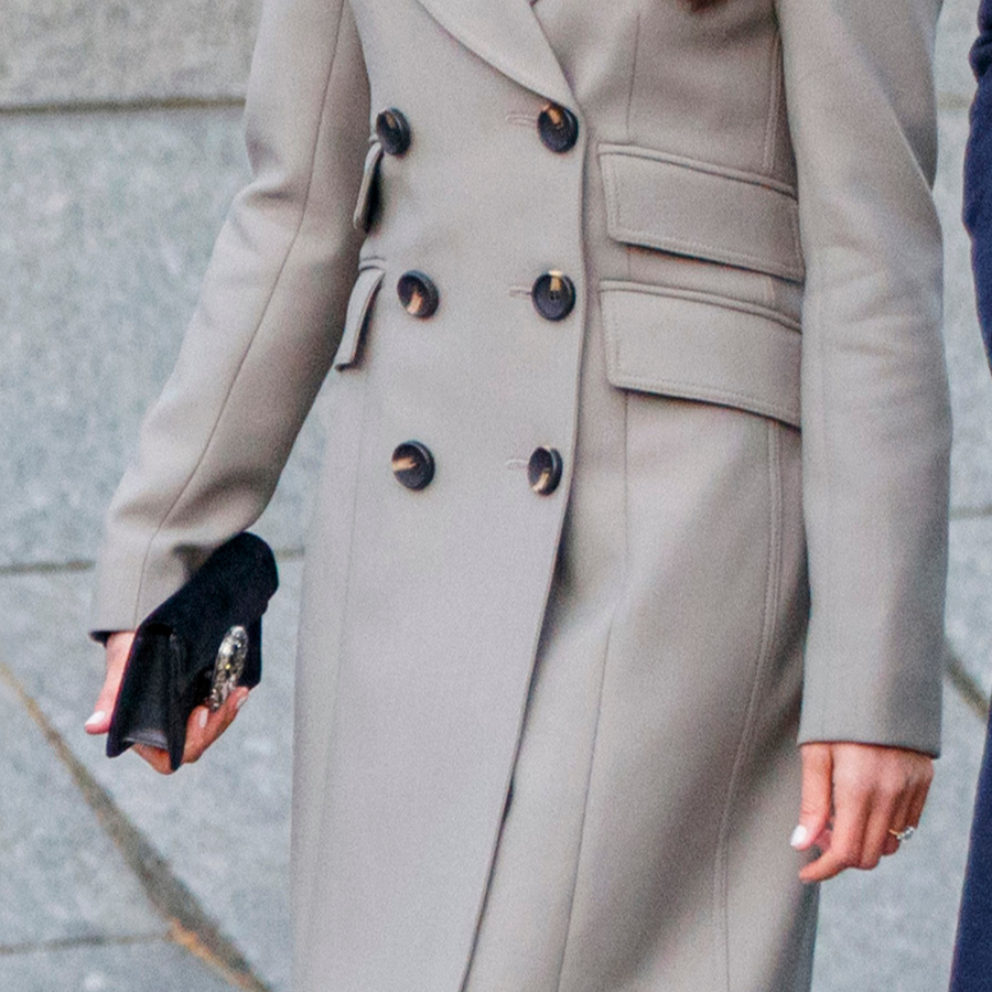 Meghan Markle carrying the Gucci Dionysus clutch bag