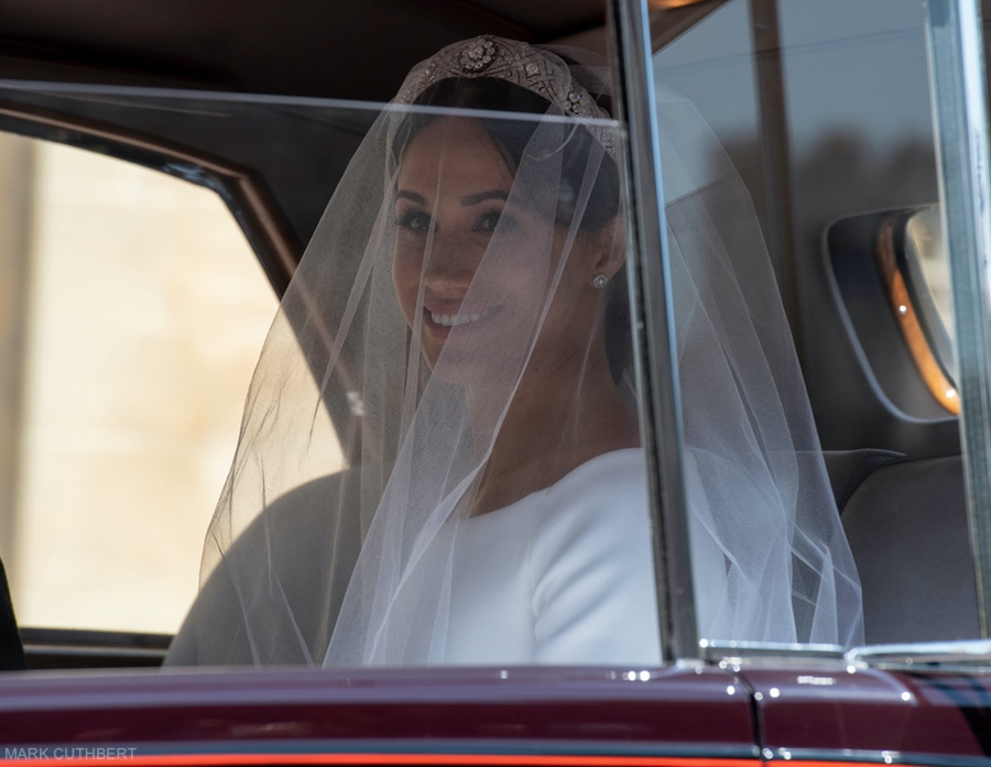 Meghan Markle in her veil in the car before the wedding