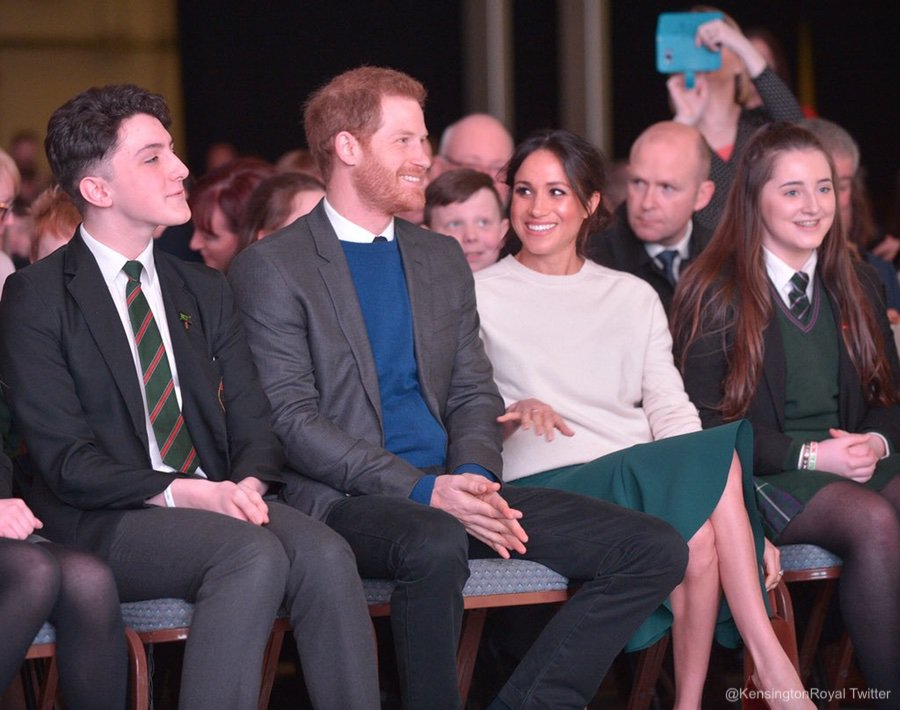 Meghan and Harry watching a performance in Belfast