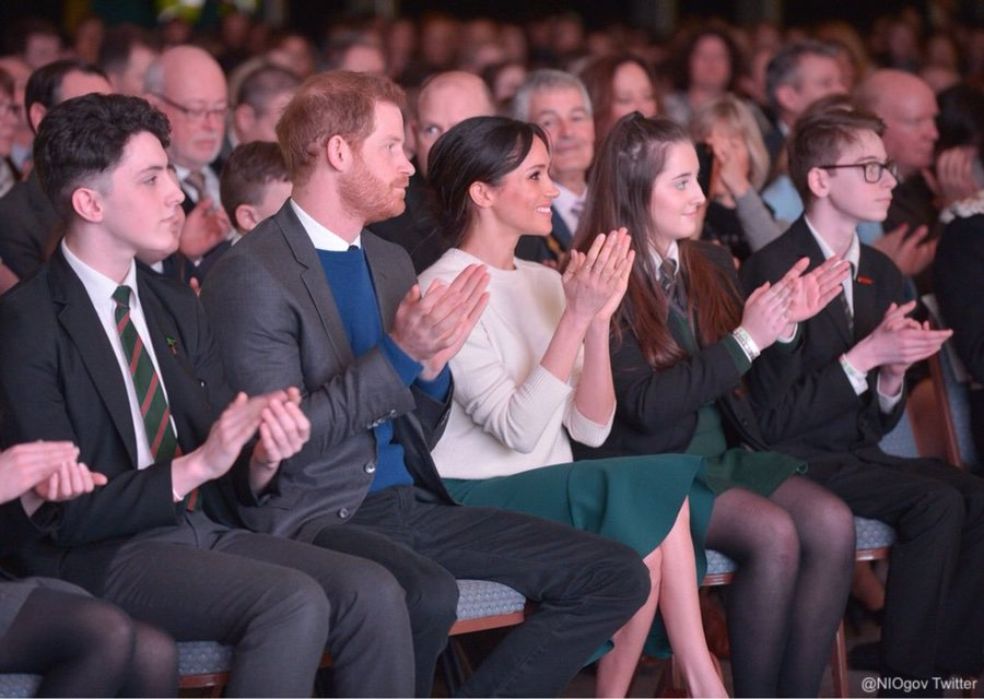 Meghan and Harry watching performances