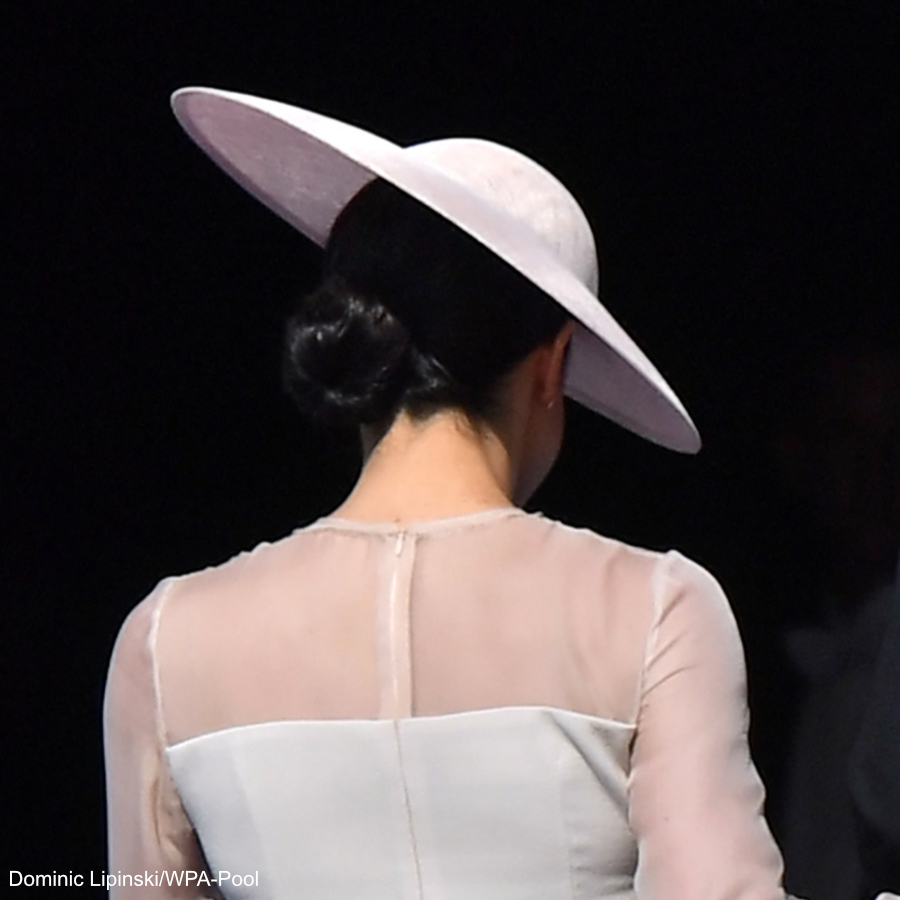 Meghan Markle's hair in a bun under her hat